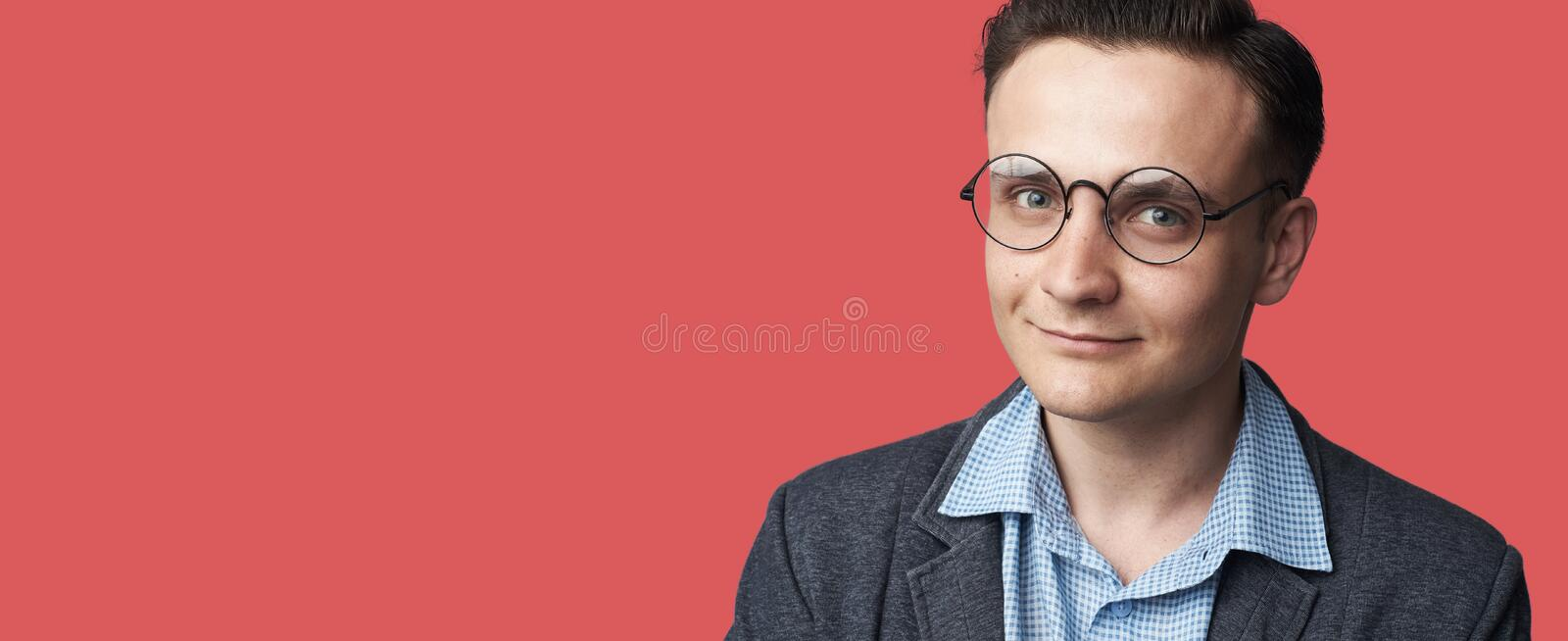 Portrait of young smiling handsome man wearing spectacles royalty free stock photo