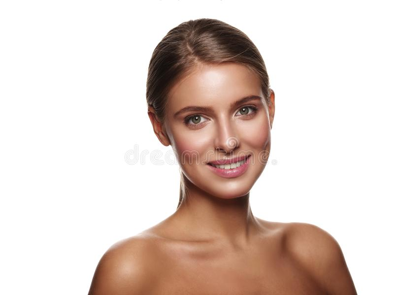 Portrait of a young smiling healthy and beautiful girl without makeup.  royalty free stock photo