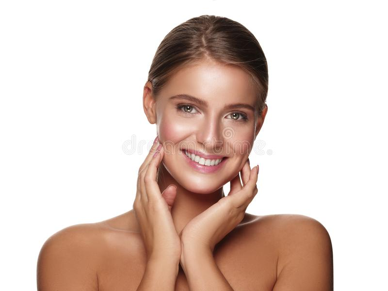 Portrait of a young smiling healthy and beautiful girl with nude makeup. Portrait of a young smiling healthy and beautiful girl without makeup, white background stock photo