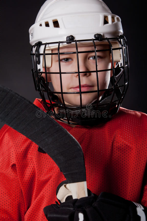 Portrait of a young smiling ice hockey player stock image
