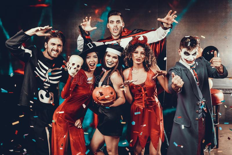 Portrait of Young Smiling People in Scary Costumes stock image
