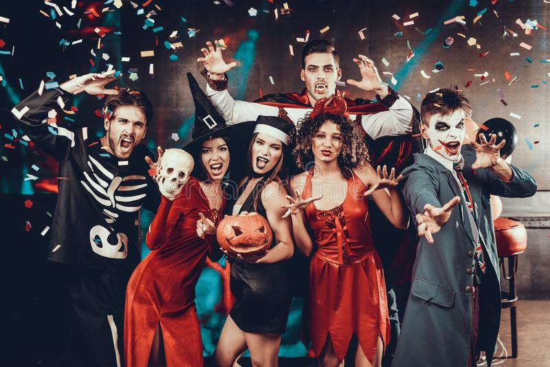 Portrait of Young Smiling People in Scary Costumes stock photography