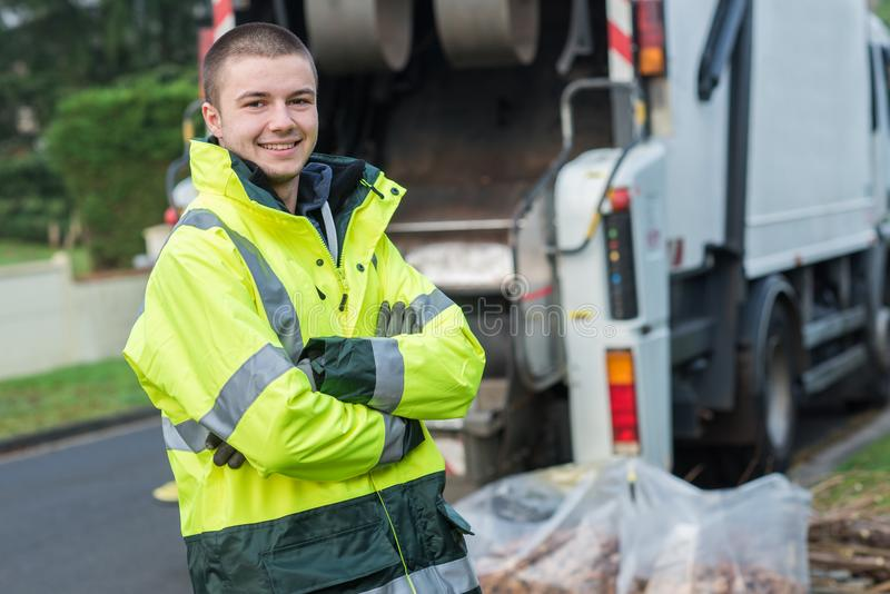 Portrait young smiling refuse collector royalty free stock photography