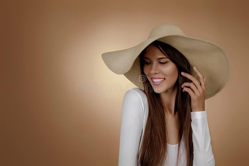 Young woman in fashionable summer hat royalty free stock photography