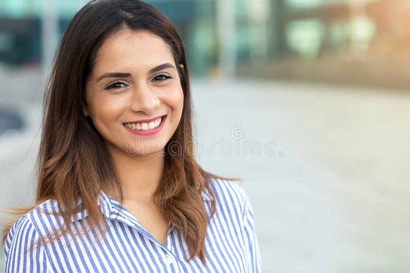 Portrait of young smiling woman outdoor with sunligth flare and copy space stock photo