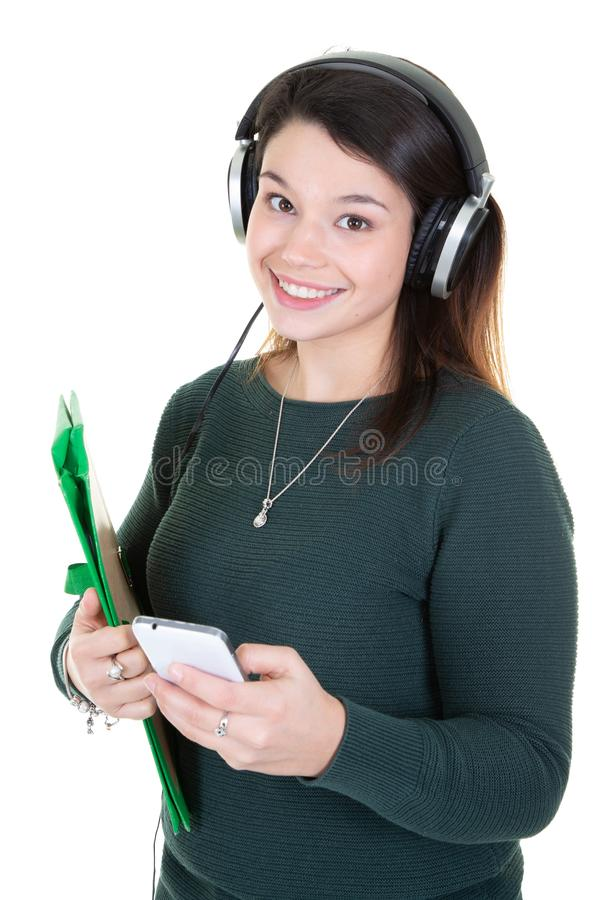 Portrait of young smiling woman student with headphones and mobile phone royalty free stock photography