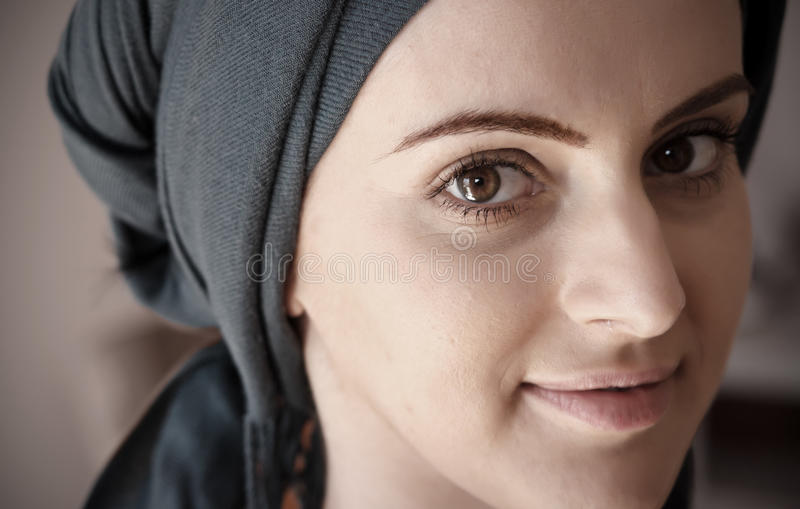 Portrait of young smiling woman wearing scarf stock photos