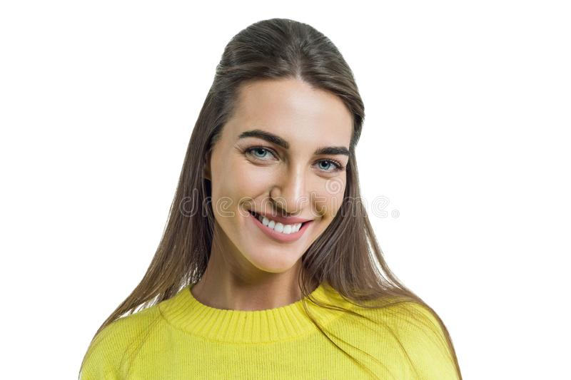 Portrait of young smiling woman in yellow sweater close-up, female with perfect white smile posing on white background, isolated stock photography