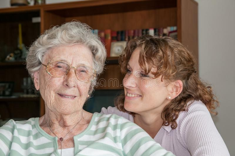 Portrait of granddaughter and her grandmother stock photos