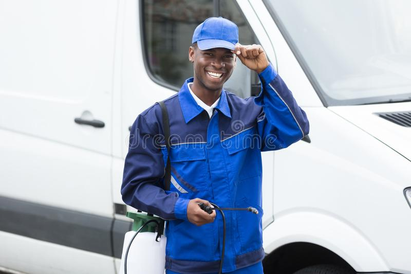 Young Smiling Male Worker With Pesticide Sprayer stock image