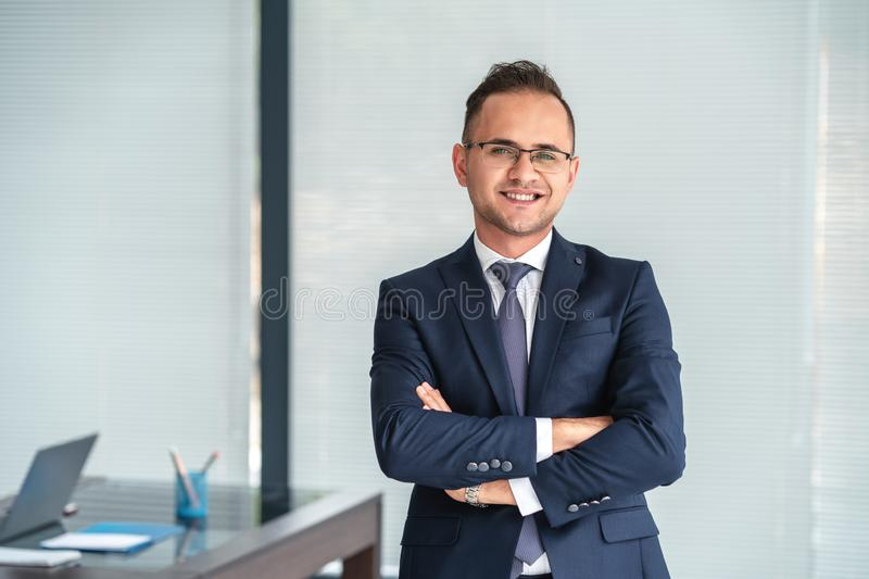 Portrait of a young smily businessman in office with self confident. royalty free stock image
