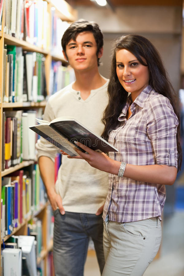 Download Portrait Of Young Students Holding A Book Stock Image - Image: 21145923