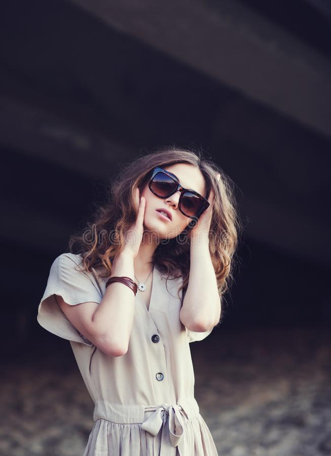 Portrait of a young stylish girl stock photos