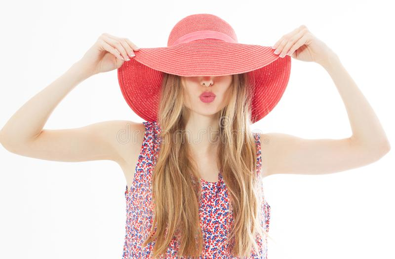 Portrait of young stylish kissing girl model in colour casual summer clothes in red pink hat with natural makeup and long blond stock photo