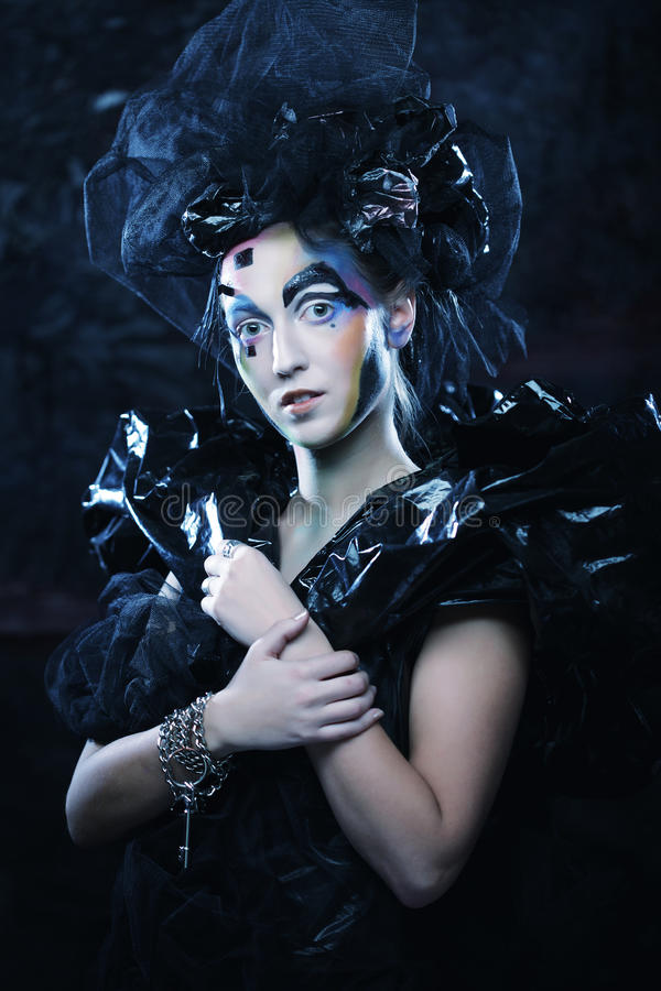 Portrait of young stylisn woman with creative visage. Halloween party stock image