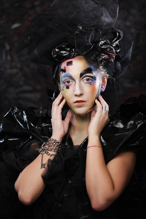 Portrait of young stylisn woman with creative visage. Halloween party royalty free stock image