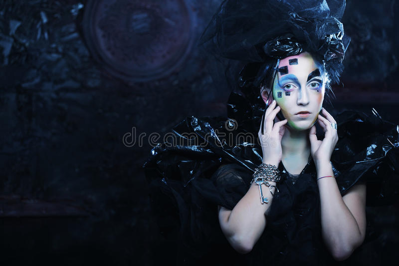 Portrait of young stylisn woman with creative visage. Halloween party stock photography
