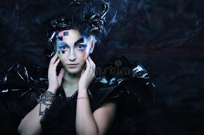 Portrait of young stylisn woman with creative visage. Halloween party stock photos