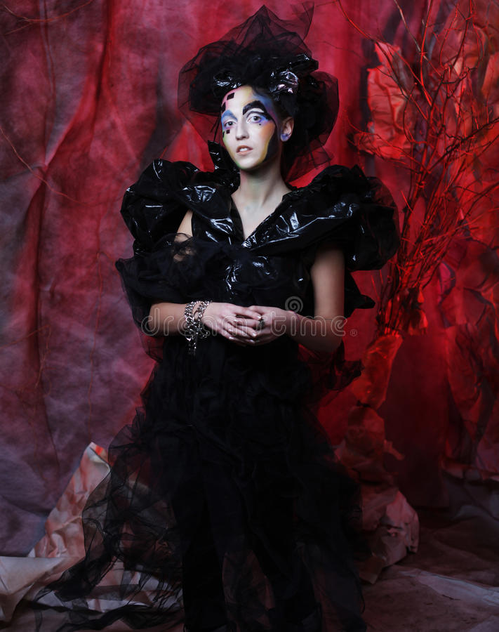 Portrait of young stylisn woman with creative visage. Halloween party royalty free stock photos