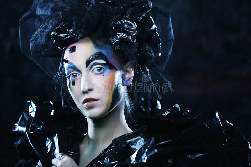 Portrait of young stylisn woman with creative visage. Halloween party stock photo