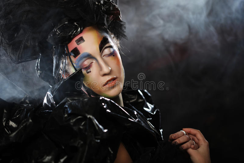 Portrait of young stylisn woman with creative visage. royalty free stock image