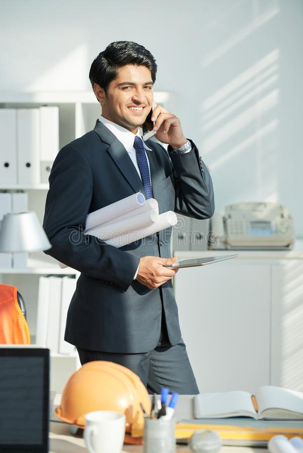 Successful architect working at office royalty free stock image
