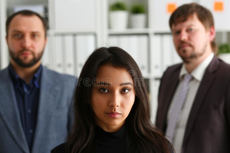 Portrait of businesslady and two businessmen in office stock image