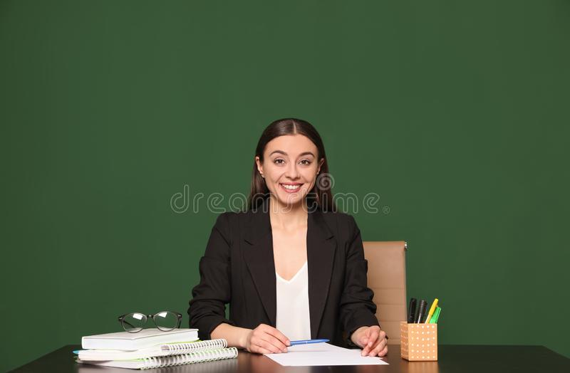 Portrait of young teacher at table stock photo