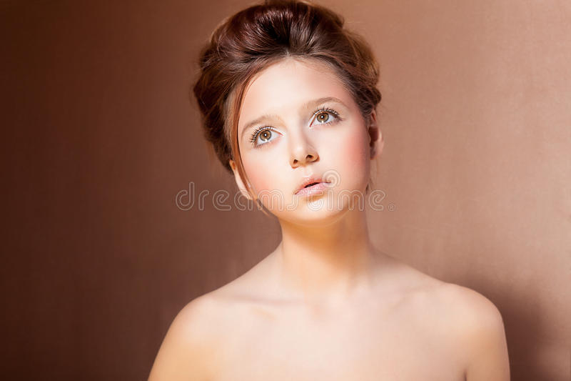 Portrait of Young Teen Girl over Beige Background royalty free stock images