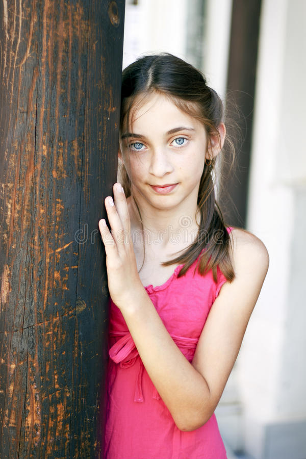 Download Portrait Of A Young Teen Girl To A Wooden Column Stock Image - Image of hair, girls: 26156935
