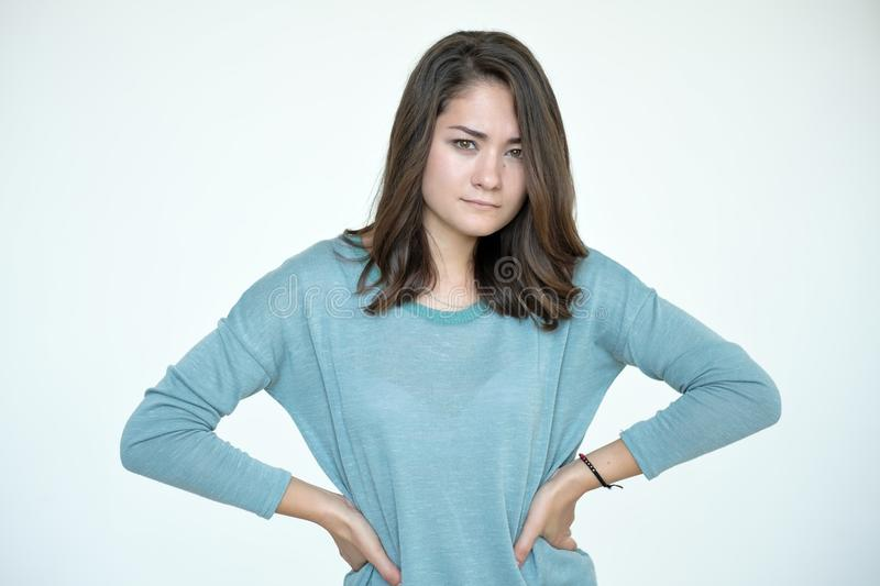 Portrait of beautiful young angry woman in blue t-shirt stock photo