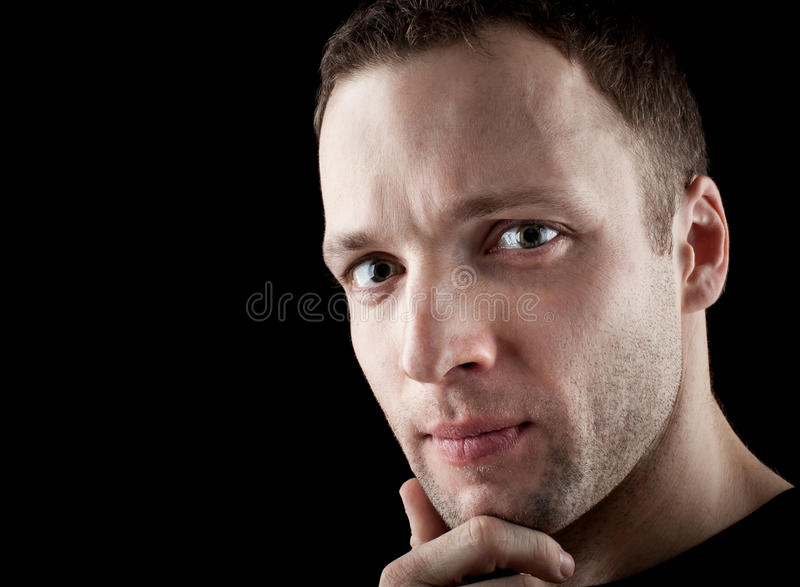 Portrait of young thinking unshaven man