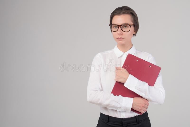 Young serious business girl holds folder isolated royalty free stock image