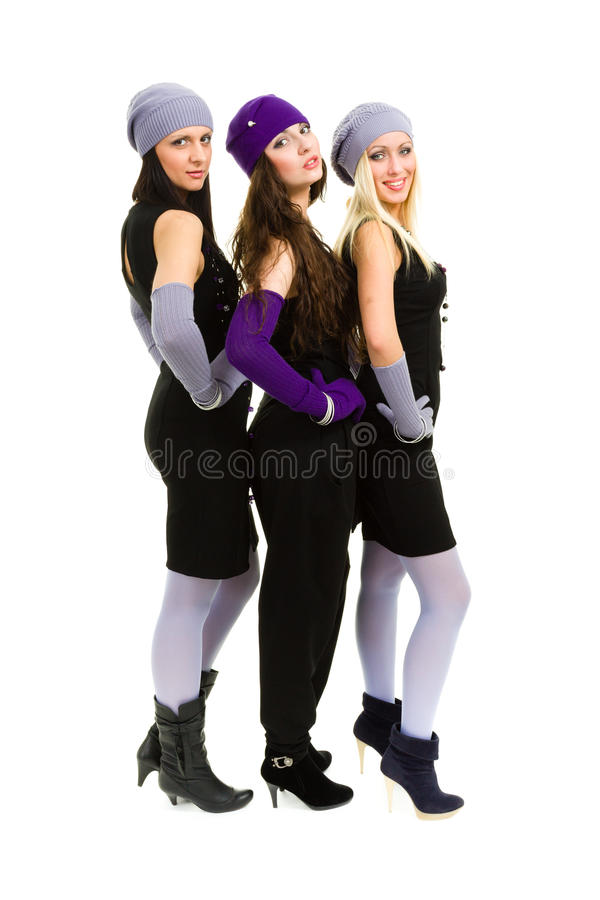 Three women in white knit wool hat and mittens. Portrait of a young three women in white knit wool hat and mittens. Isolated on white background in full body stock photos