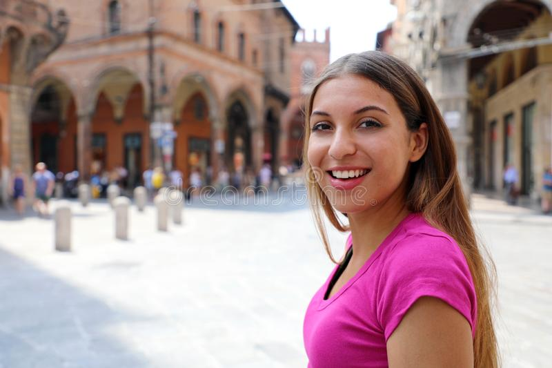Portrait young tourist woman in italian medieval old town stock photography
