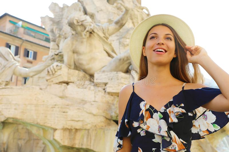 Portrait of young tourist woman visiting Piazza Navona square landmark in Rome. Summer holidays in Italy stock photography