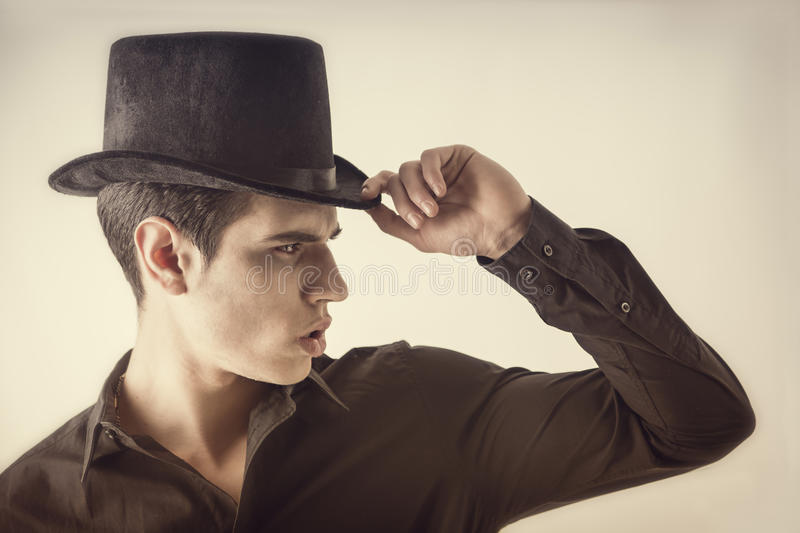 Portrait of a Young Vampire Man with Black Shirt and Top Hat royalty free stock images