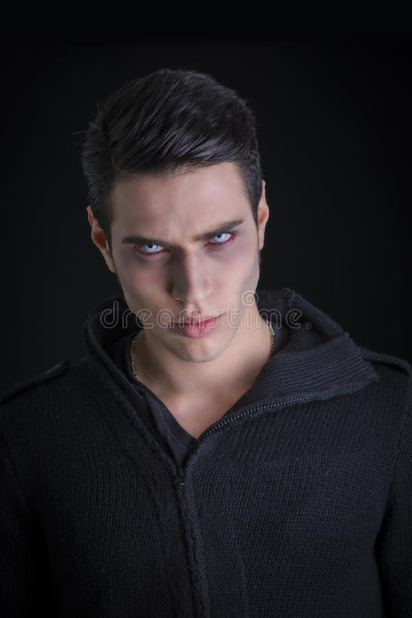 Portrait of a Young Vampire Man with Black Sweater royalty free stock image