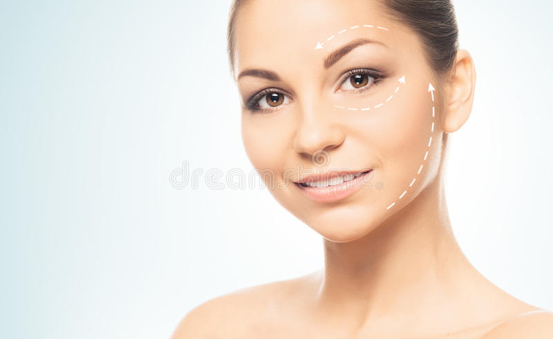 Portrait of a young woman with arrows and lines. Close-up portrait of young, fresh and natural woman with the dotted arrows (spa, surgery, face lifting and make royalty free stock images