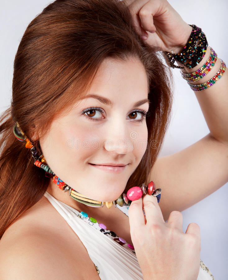 Portrait of a Young Woman with beads on her neck stock images