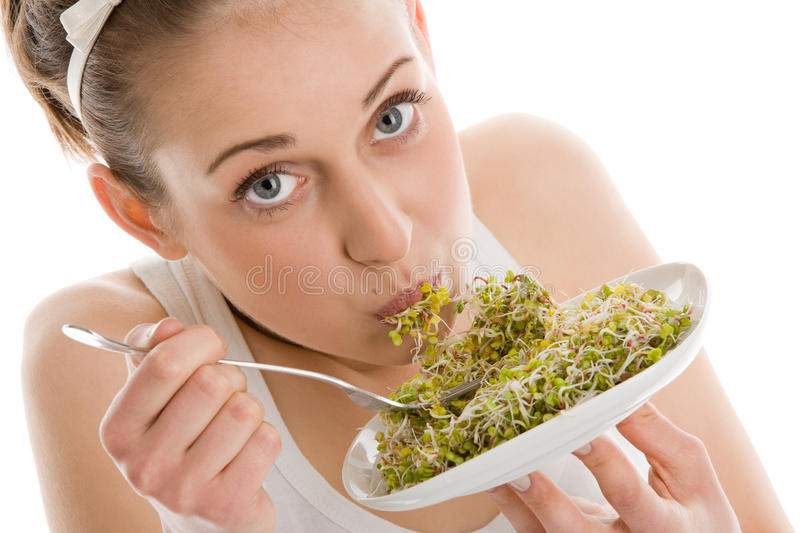 Woman eating soy bean sprouts royalty free stock photography