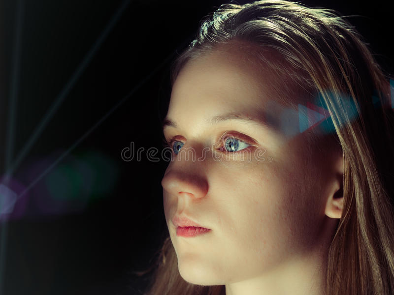 Portrait of a young woman on black background royalty free stock photography