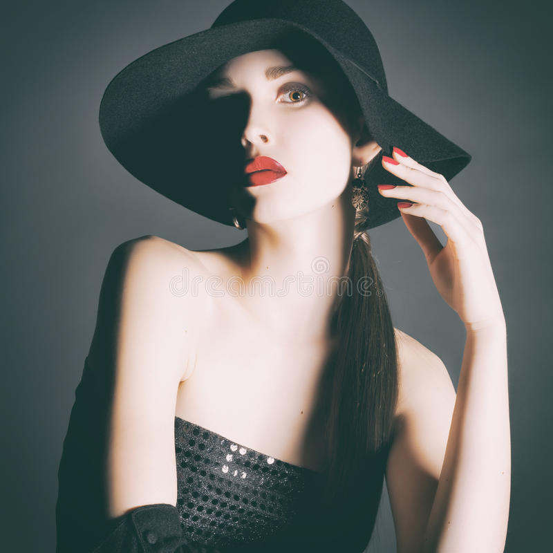 Portrait of young woman in a black hat. stock photography