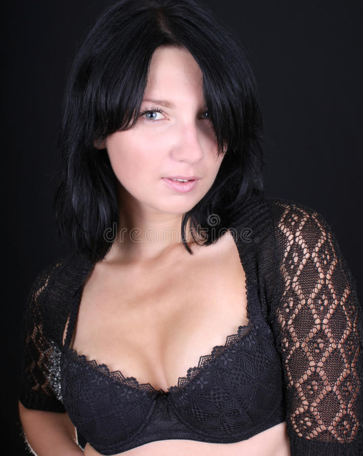 Portrait of  young woman in black lingerie