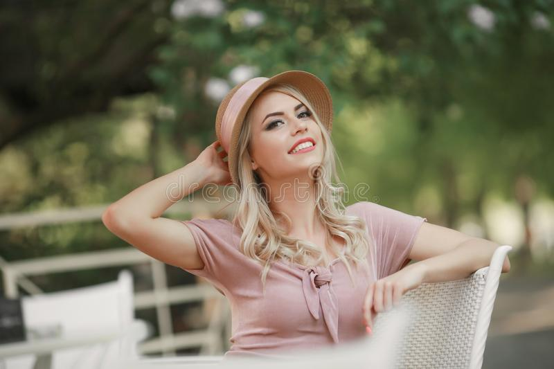 Portrait of a young woman, blonde, glasses, outdoors in the park stock photo