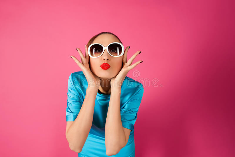Portrait on young woman in blue dress and white sunglasses royalty free stock images