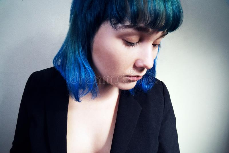 Portrait of a young woman with blue hair. Portrait of a young woman with blue hair in a jacket royalty free stock photos
