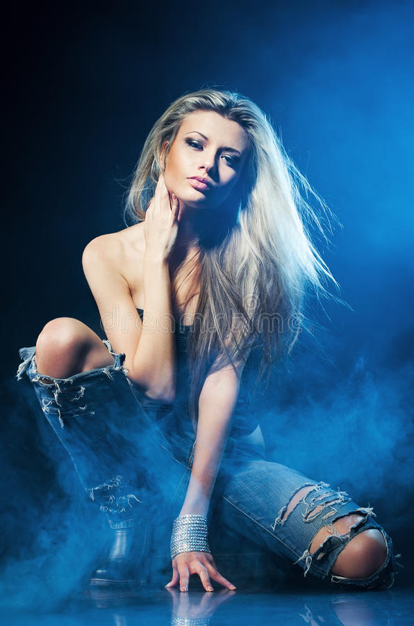 Portrait of young woman in the blue smoke stock photography