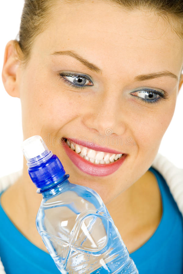 Portrait of a young woman with a bottle of water stock images