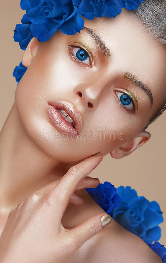 Portrait of Young Woman with Bronzed Skin and Blue Eyes stock photography
